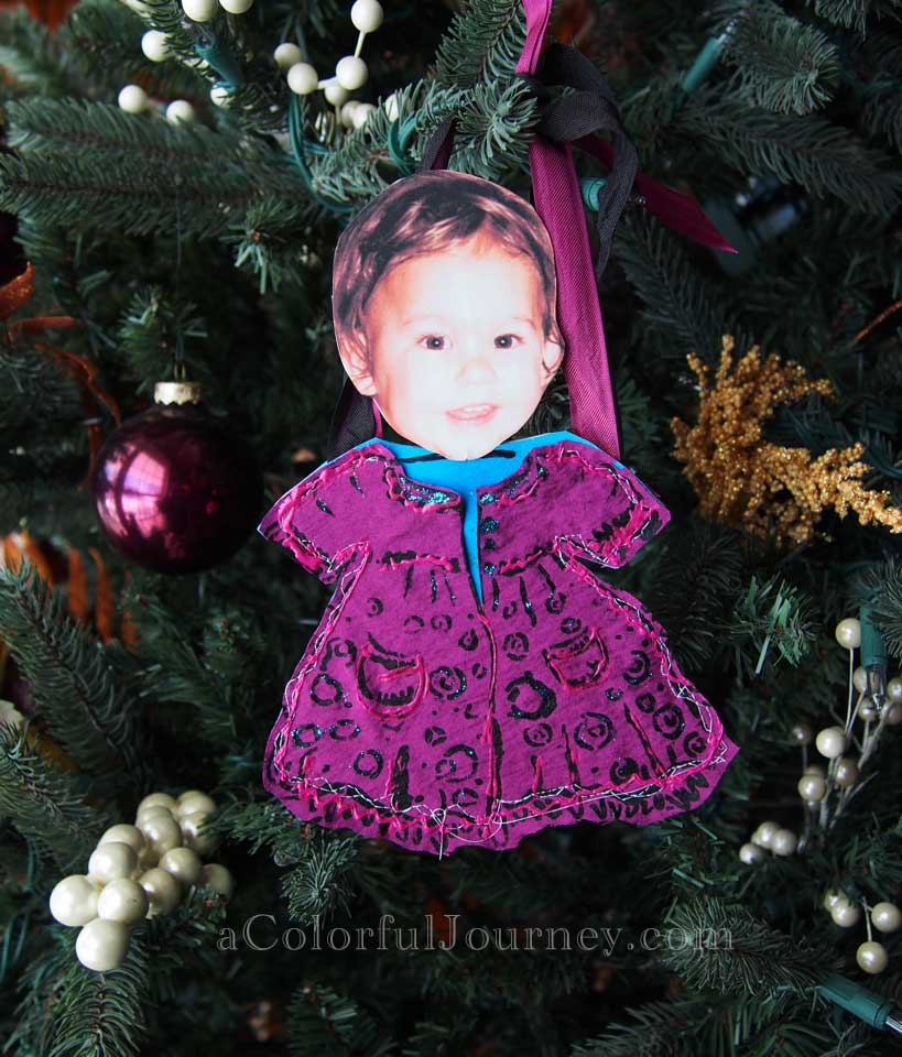 Video tutorial showing how to use a stencil, fabric, and a Gelli print to make an ornament by Carolyn Dube
