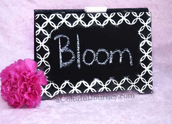 Video tutorial showing how to make a stenciled chalkboard sign by Carolyn Dube