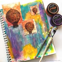 She started this art journal page with a big random mess and the shares it layer by layer!