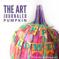 Video showing to art journal a pumpkin for Halloween- bright and happy rainbow colors!