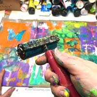 Video showing how the layers built up with gelli printing® and mask on a paper bag for the Let's Play link party