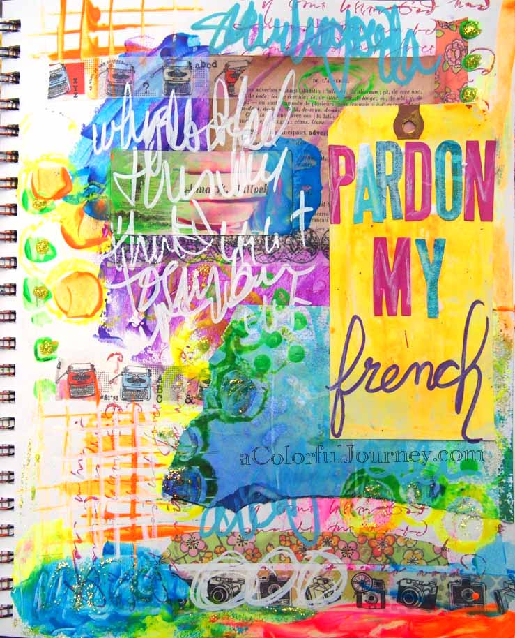 Video of a colorful art journal page with Carolyn Dube
