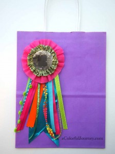 Video showing how to build a colorful award ribbon with Carolyn Dube