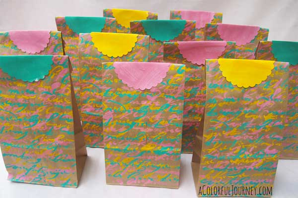 Video showing how to turn plain paper lunch bags into wonderful stenciled gift bags!