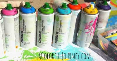 Using chalk spray paints to go crazy with graffiti outside...and it will all wash away by Carolyn Dube