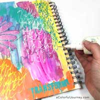 How to take an ugly art journal page and make it better with glitter and a stencil