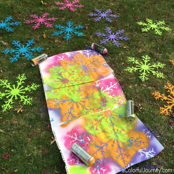 Liquitex spray paint and plastic snowflakes for a bright and rainbow decoration!