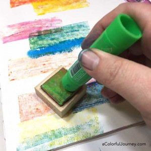 Video tutorial using playcolor paint sticks with rubber stamps to make an art journal background for this week's Let's Play link party!