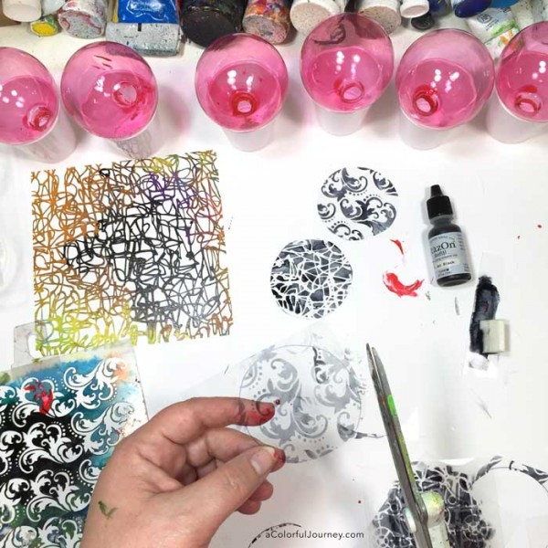 Video tutorial sharing how to get your stenciling inside a glass ornament