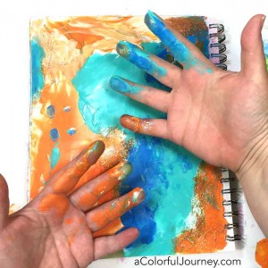 Finding inspiration for play from kids for this Let's Play video all about fingerpainting in an art journal