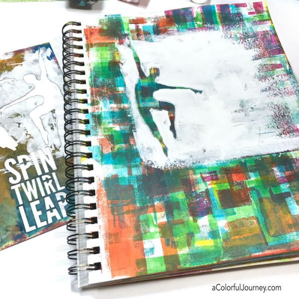 Adding a layer to my art journal with a dancing stencil and I made a huge OOPS but a baby wipe fixed it all!