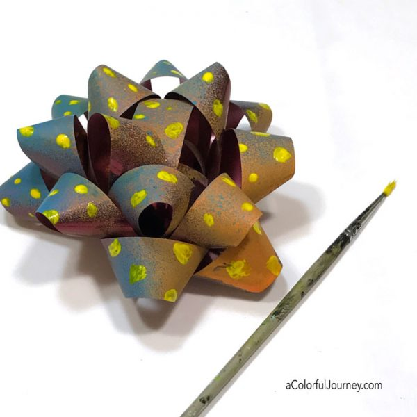 Upcycling leftover holiday bows mixed media style with spray paint tutorial by Carolyn Dube