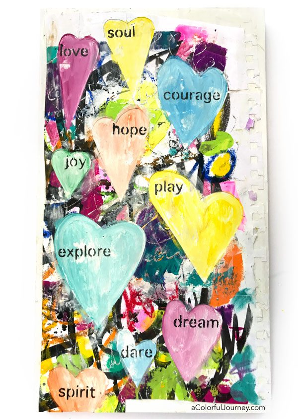 Leftover scraps become stenciled and watercolored mixed media wall art tutorial by Carolyn Dube
