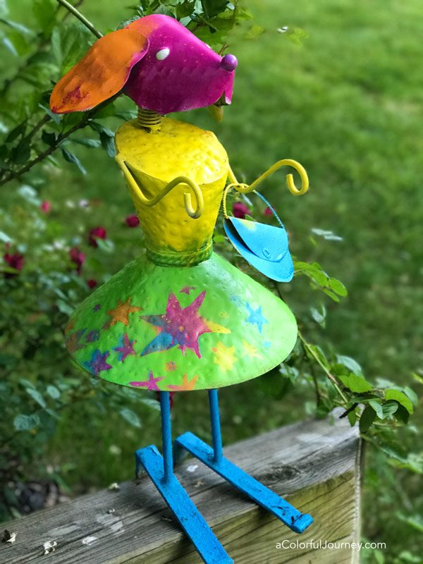 Rainbowizing an old garden statue with stencils and spray paint