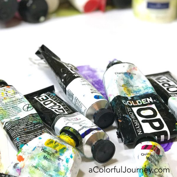 Gel printing with a toy action figure and Golden Open paints on a Gel Press Plate video tutorial by Carolyn Dube