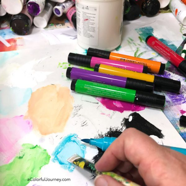 Using Pitt Pens to create colorful paint to create a background in a 150 year old ledger that became an art journal